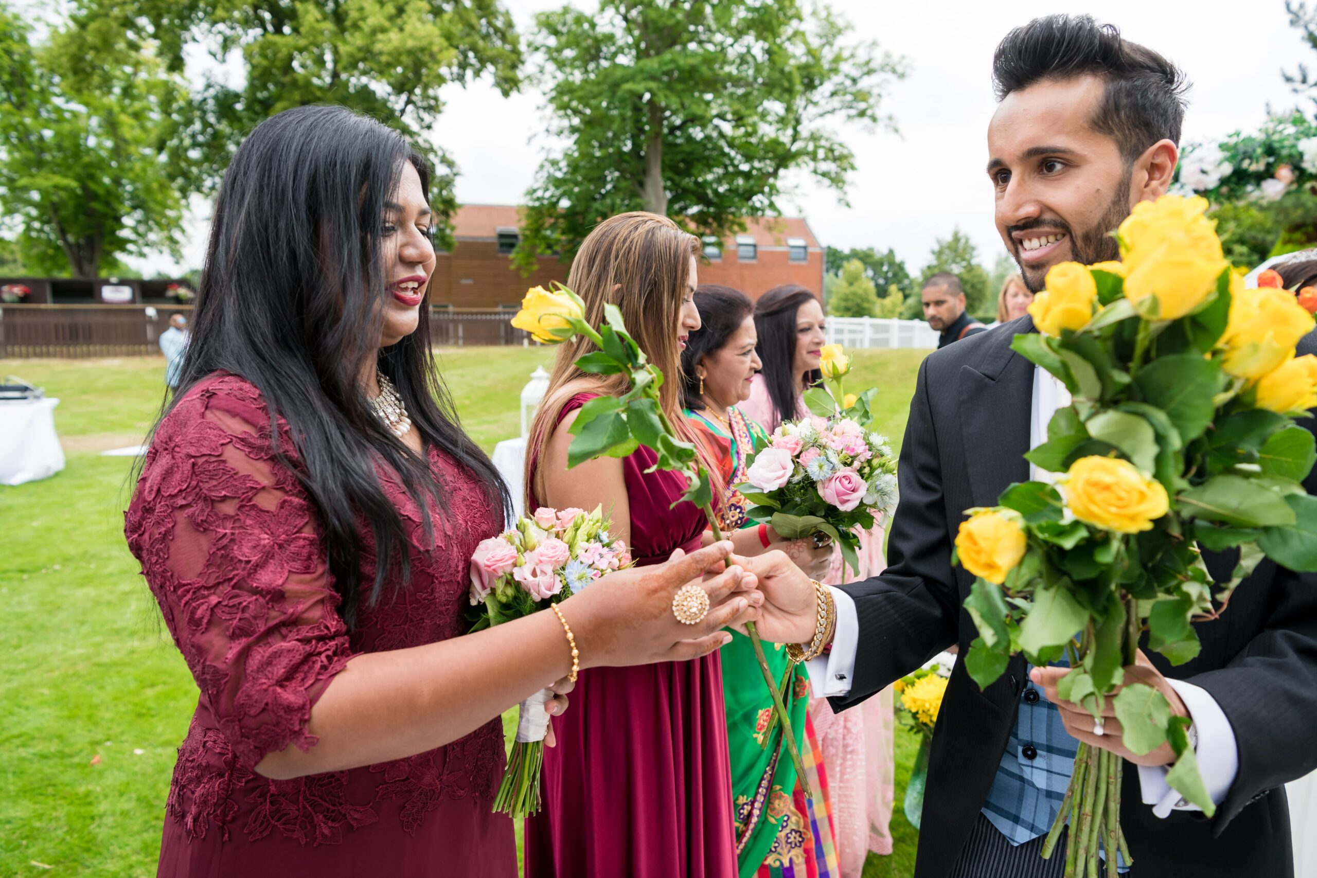 Handsome Asian Groom performing a rose ceremony