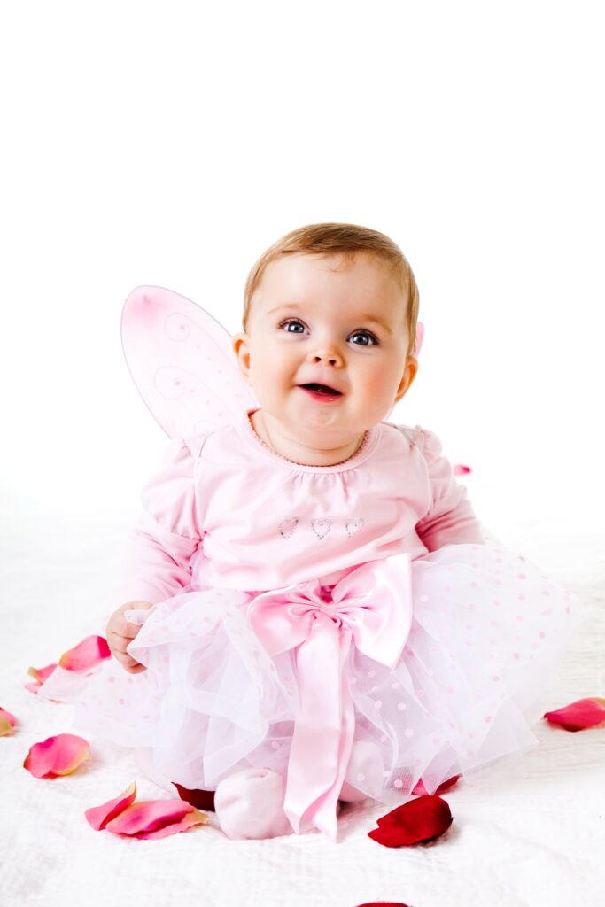 Photo of a young girl dresses in a pink tutu