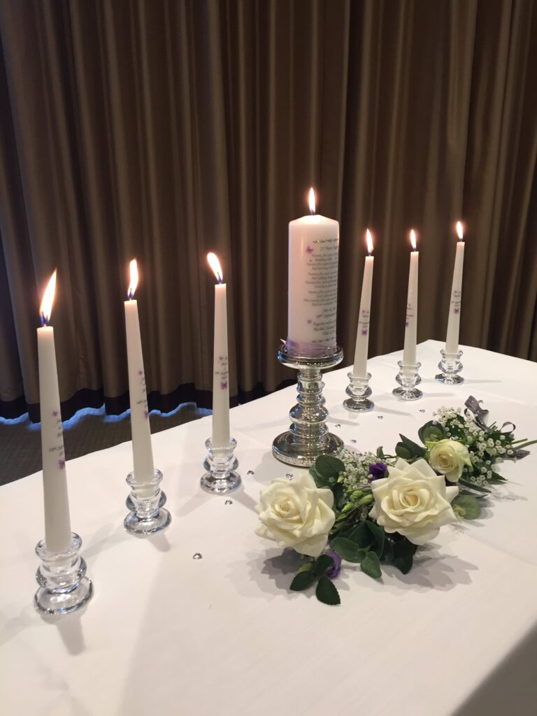 photo of  candles on a white tablecloth